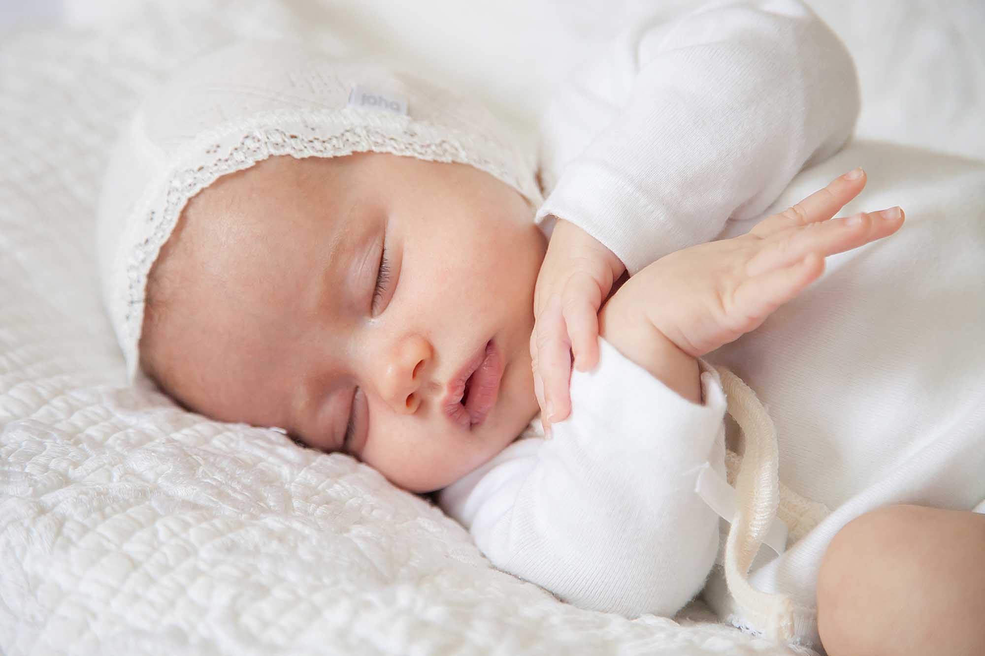 Baby Photographer East Grinstead | Baby sleeping on a bed